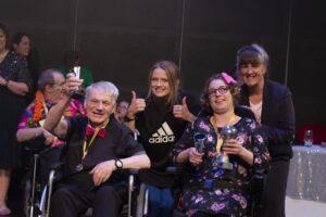 Owen Rowlands and Kayleigh Baynes receiving their award