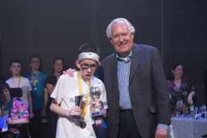 Rhodri Thompson receiving his award from Lord Peter Hain