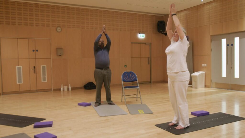 A man taking part in an activity session with an instructor