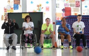 Inclusive Boccia session Group of disabled people having fun playing a game of Boccia